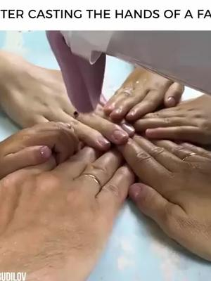 Plaster casting the hands of a familyCredit: Evgeniy Budilov (tinyurl.com/qpy2yvw)
